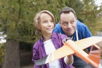 Father and son playing with model airplane — Stock Photo