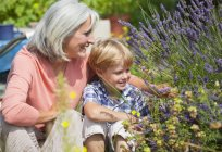 Mature woman with boy in garden — Stock Photo