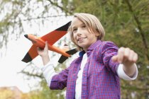 Boy playing with toy aircraft — Stock Photo