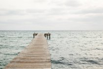 Wooden jetty at sea — Stock Photo