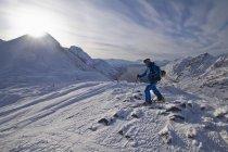 Norway, Skier walking in snow with ski pole — Stock Photo