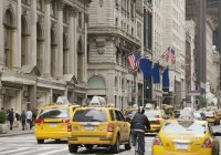 USA, New York, central street with traditional yellow cabs — Stock Photo