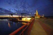 Germany, North Rhine Westphalia, Dortmund, illuminated harbour office at dusk — Stock Photo