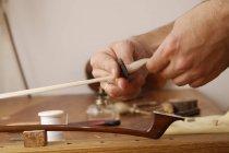 Craftsman making fiddlestick for violin — Stock Photo