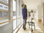 Senior women holding walking frame — Stock Photo