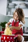 Girl playing with spaghetti — Stock Photo