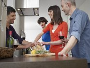 Men and women cooking together — Stock Photo