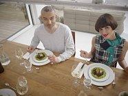 Man and woman having dinner — Stock Photo