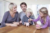 Cute family having fun at home interior at daytime — Stock Photo