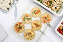 Mini Quiches at table at buffet — Stock Photo