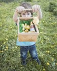 Little boy showing his basket with chocolate Easter bunnies — Stock Photo