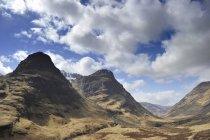 UK, Scotland, Glen Coe highlands under clouds — Stock Photo