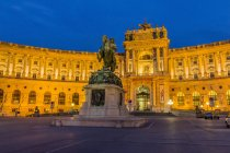 Austria, Vienna, view to lighted Hofburg Palace at twilight — Stock Photo