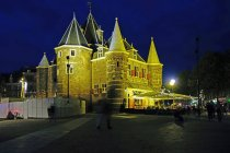 Netherlands, North Holland, Amsterdam, Nieuwmarkt, illuminated De Waag at night — Stock Photo