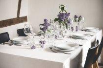 Festive laid table with lilac, Syringa — Stock Photo