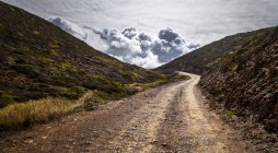 Portugal, Street to Ponta Ruiva and clouds on background — Stock Photo