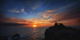 Spain, Menorca, silhouette on rock formation at Mediterranean coast — Stock Photo