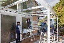 Men assembling glass canopy at daytime, Rhineland Palatinate, Germany — Stock Photo