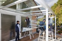 Men assembling glass canopy at daytime, Rhineland Palatinate, Germany — Stock Photo