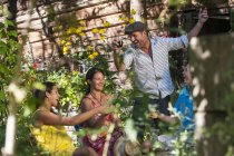 Cheerful family having garden party with drinks in Salzburg, Austria — Stock Photo