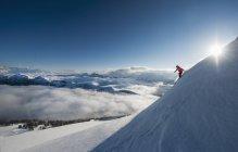 Austria, Salzburg, Mid adult man skiing in mountain of Altenmarkt Zauchensee — Stock Photo