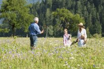Farmer and family in summer meadow in Salzburg, Austria — Stock Photo