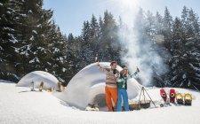 Couple having fun in front of igloo — Stock Photo