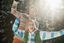 Couple having fun in snow — Stock Photo