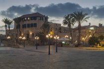 Israel, Jaffa. Square with hotel and restaurants at night — Stock Photo