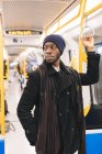 African american man in underground train — Stock Photo