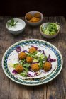 Falafel, wrap, salad, red and white cabbage, yogurt sauce with mint — Stock Photo