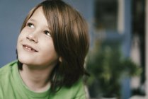 Portrait of smiling boy looking up — Stock Photo