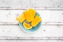 Close up of Homemade orange popsicles — Stock Photo