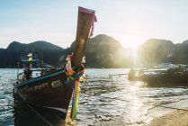 Thailand, Phi Phi Islands, Ko Phi Phi, moored long-tail boat in backlight — Stock Photo