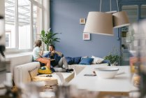 Father and son having snack at home — Stock Photo