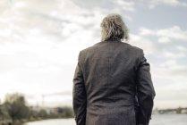 Rear view of senior man at lake — Stock Photo
