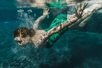 Woman diving in a swimming pool — Stock Photo