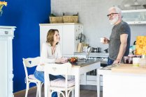 Happy mature couple in kitchen at home — Stock Photo