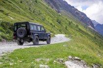 Italy, Piemont, Landrover on gravel road — Stock Photo
