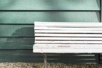 Empty white wooden bench — Stock Photo