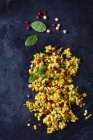 Couscous salad with chick peas and cranberries on dark ground — Stockfoto