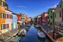 Italy, Veneto, Burano, canal with boats and colourful houses — Stock Photo