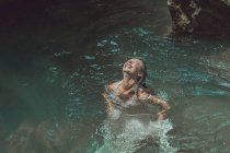 Laos, Woman in a white dress in a blue lagoon — Stock Photo