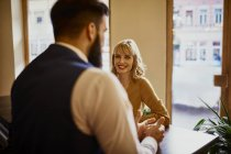 Elegant woman smiling at man in a bar — Stock Photo