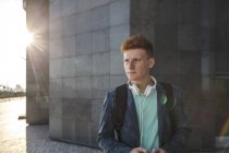 Redheaded young man outdoors with headphones — Stock Photo
