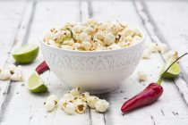 Bowl of popcorn flavoured with chili and lime — Stock Photo