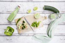 Glass bottles of homemade green Gazpacho and ingredients — Photo de stock