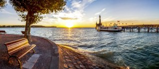 Germany, Baden-Wuerttemberg, Constance, Lake Constance, Impera at harbour entrance, sunrise — Stock Photo