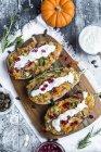 Filled aubergine, bulgur, pumpkin, pomegranate, zucchini, rosmary, tzaziki, mint, vegetables — Stock Photo