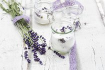 Glass of homemade lavender sugar with lavender blossoms — Stock Photo